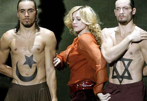 http://chismetime.com/wp-content/uploads/2008/10/madonna-jewish-star-of-david.jpg